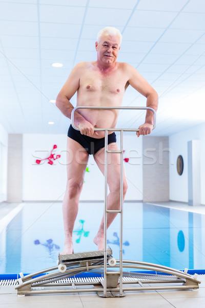 Kıdemli su jimnastik tedavi adam sualtı Stok fotoğraf © Kzenon