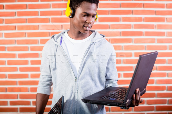 Hacker or computer programmer with laptop Stock photo © Kzenon