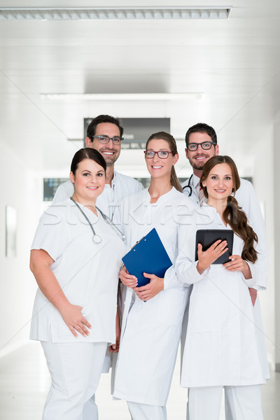 Team of doctors standing in hospital corridor Stock photo © Kzenon
