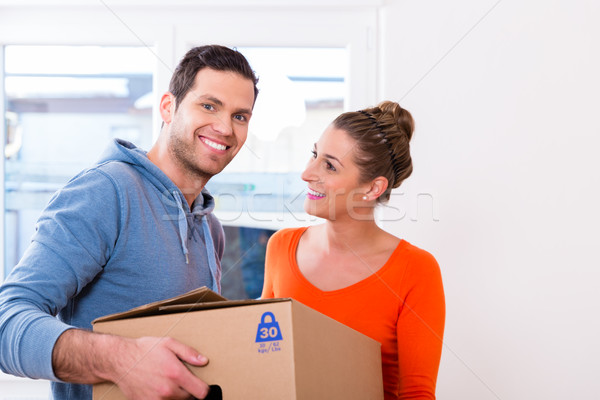 Couple moving house carrying packing cases Stock photo © Kzenon