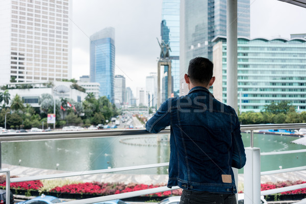 Rear view of a young man looking at a historic monument in a fam Stock photo © Kzenon