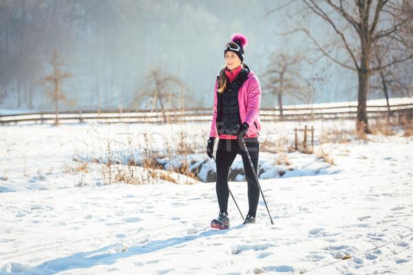 Nő nyom tél túrázik napos tájkép Stock fotó © Kzenon
