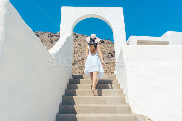 Woman climbing stairs in Greece Stock photo © Kzenon