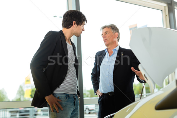Man buying car from salesperson Stock photo © Kzenon