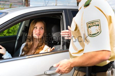 Police - woman in traffic violation getting ticket Stock photo © Kzenon