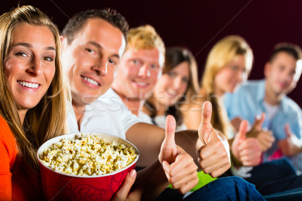 People see a movie in the cinema and have fun Stock photo © Kzenon