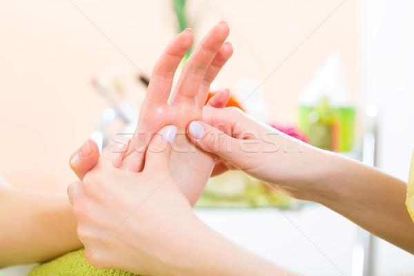 Nő manikűrös kéz masszázs manikűr virágok Stock fotó © Kzenon