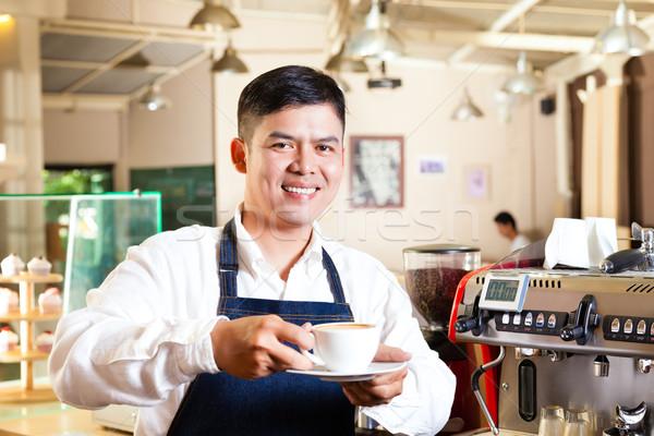 Asian Coffeeshop - barista presents coffee Stock photo © Kzenon