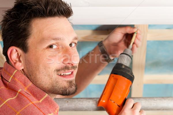 Dry waller with cordless screwdriver Stock photo © Kzenon