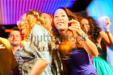 Woman in club or bar having fun Stock photo © Kzenon