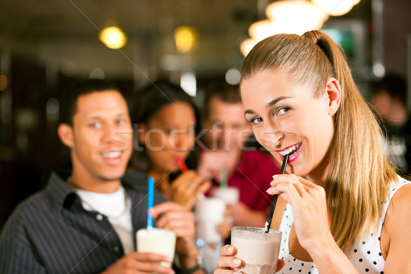 Friends drinking milkshakes in a bar Stock photo © Kzenon