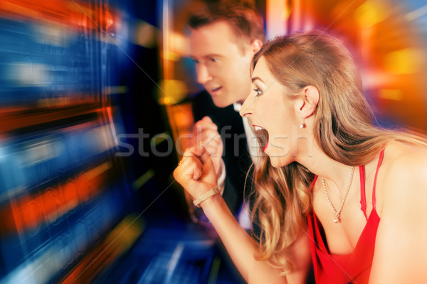 Couple in Casino on slot machine Stock photo © Kzenon