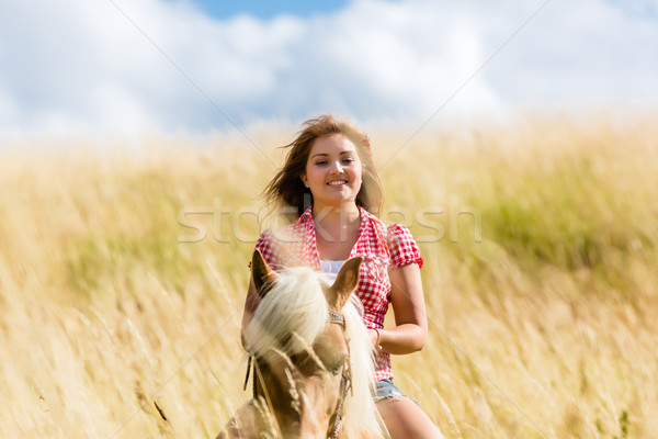 Woman riding on horse in summer meadow Stock photo © Kzenon