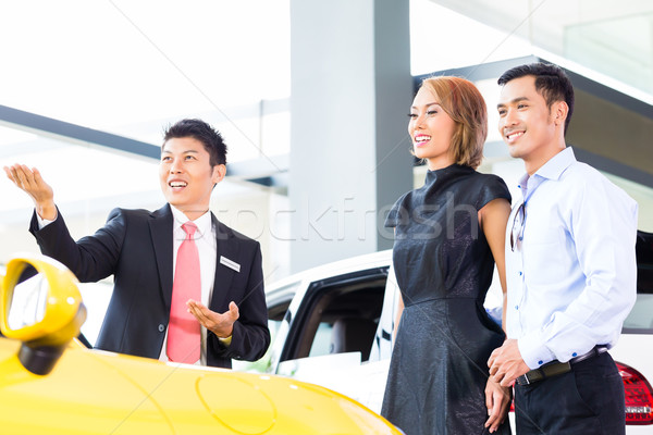 Asian couple buying car in dealership Stock photo © Kzenon