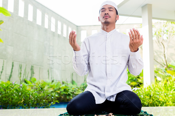 Asian Muslim man praying at home Stock photo © Kzenon