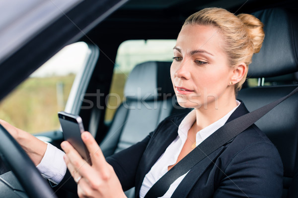 woman texting while driving by car Stock photo © Kzenon