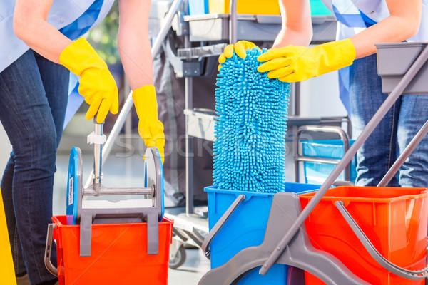 Cleaning ladies mopping floor Stock photo © Kzenon