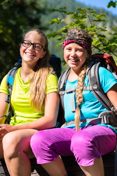 Friends or sisters hiking in the woods having fun Stock photo © Kzenon