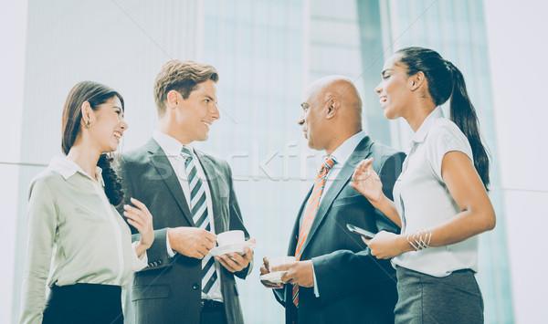International Business team meeting informally exchanging ideas Stock photo © Kzenon