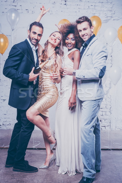 Party people with drinks celebrating new year or a birthday part Stock photo © Kzenon