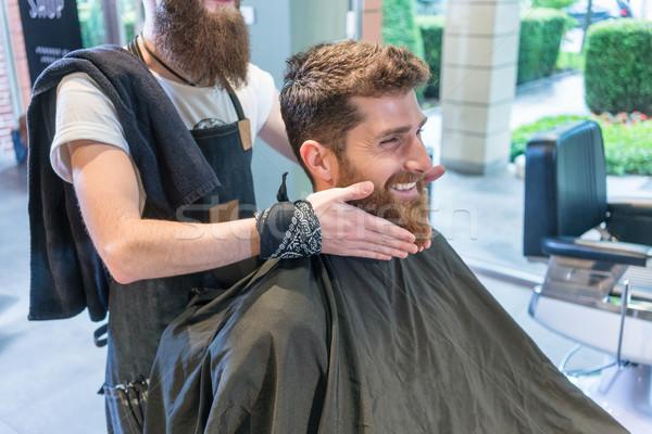 élégant jeune homme pense différent forme barbe Photo stock © Kzenon