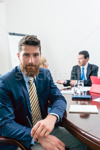 Portrait of a handsome young businessman looking at camera with confidence Stock photo © Kzenon
