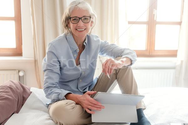 Senior woman freelancer in her study with computer Stock photo © Kzenon