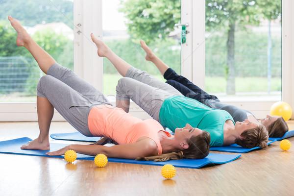 Women doing exercises for pelvis floor in postnatal course Stock photo © Kzenon