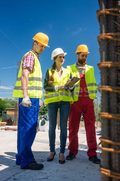 Architect supervising the work in progress on the construction Stock photo © Kzenon