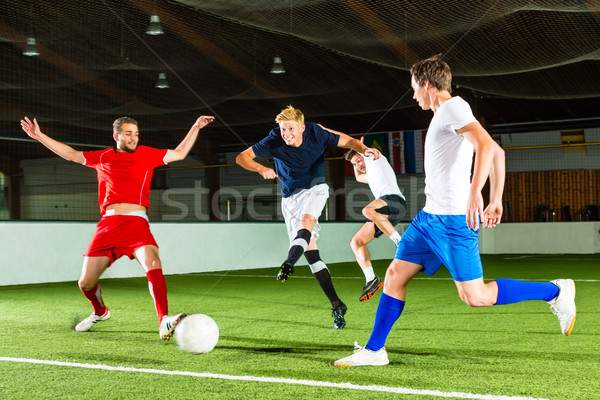 Team playing football or soccer indoor Stock photo © Kzenon