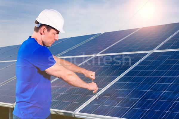technician maintaining  solar panels  Stock photo © Kzenon