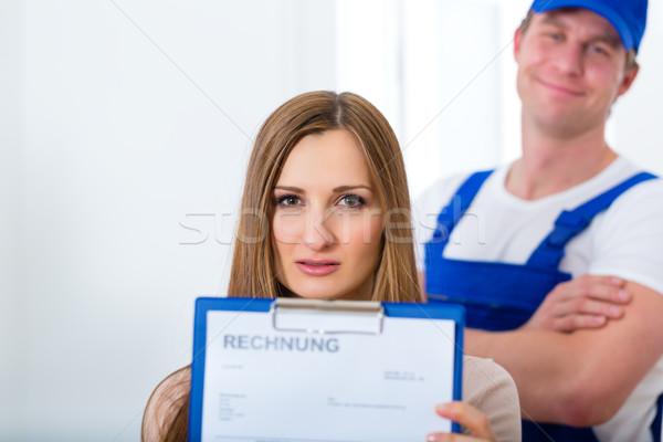 Craftsman or plumber giving overpriced invoice  Stock photo © Kzenon