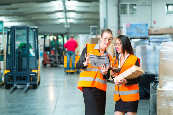 workers with package in warehouse of forwarding Stock photo © Kzenon