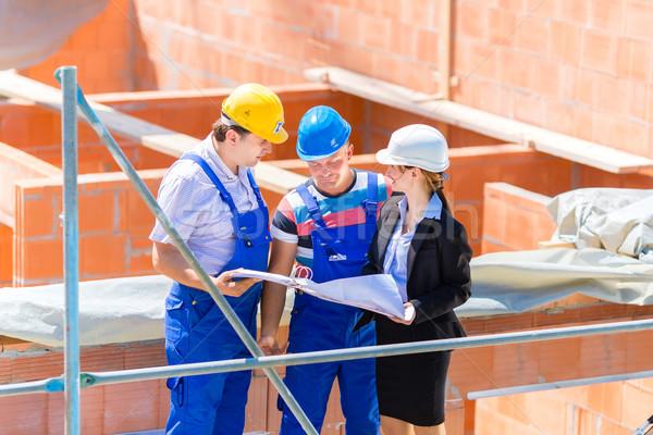 équipe construction bâtiment plans Photo stock © Kzenon