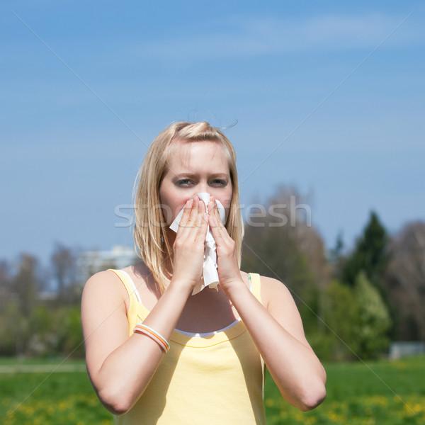 Woman with allergy sneezing Stock photo © Kzenon