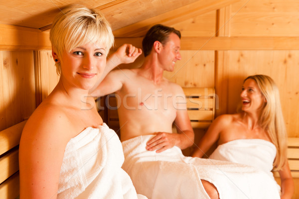 Three people in sauna Stock photo © Kzenon