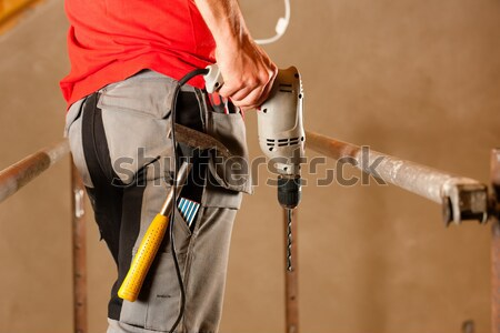 Woman Construction worker with hand drill Stock photo © Kzenon