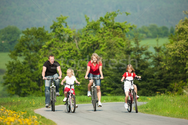 Family riding bicycles Stock photo © Kzenon