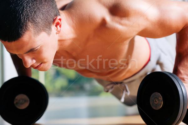 Man exercising  in gym - push ups  Stock photo © Kzenon
