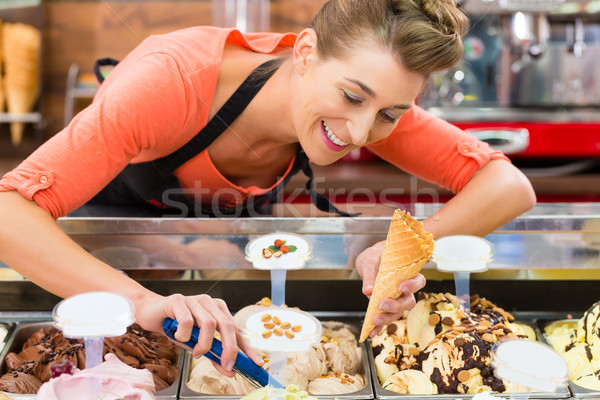 Female seller in Parlor with ice cream cone Stock photo © Kzenon