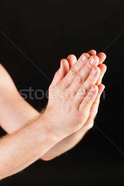 Male hand praying  Stock photo © Kzenon