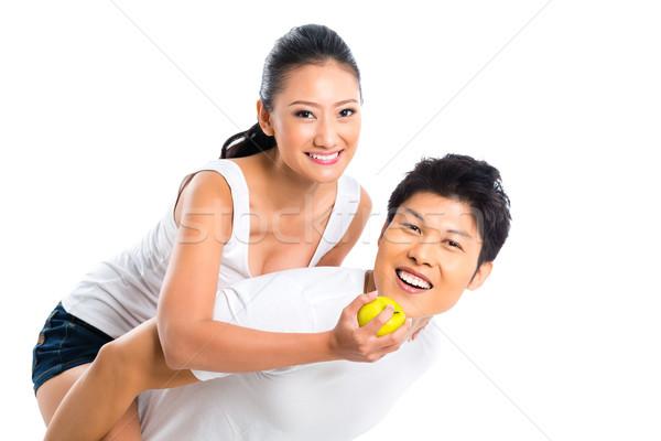 Asian couple eating and living healthy Stock photo © Kzenon