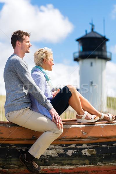 Couple enjoying holiday in beach dune Stock photo © Kzenon