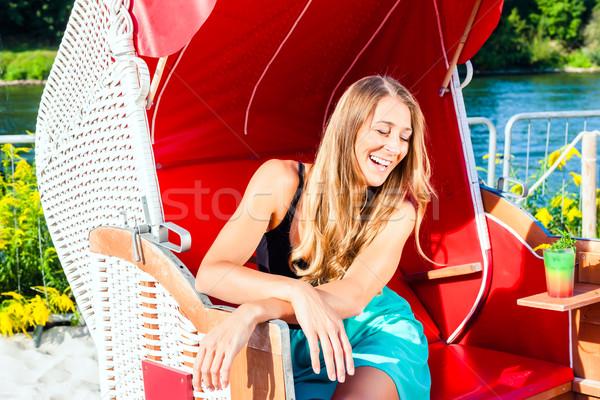 Nő fonott pad szék fiatal nő megnyugtató Stock fotó © Kzenon
