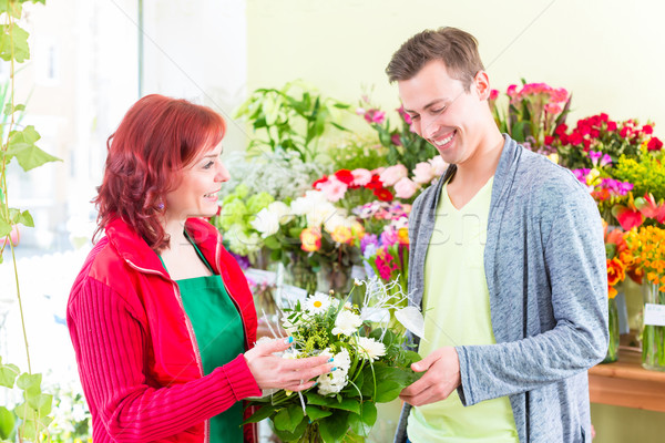 Stock photo: Costumer buying roses in flower shop