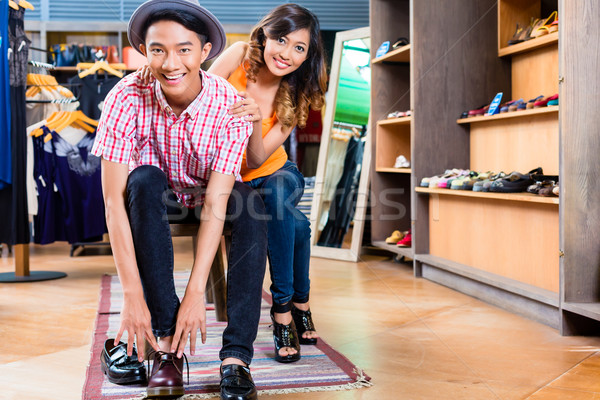 Asian couple buying shoes in store or shop Stock photo © Kzenon