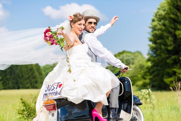 Wedding couple on motor scooter just married Stock photo © Kzenon