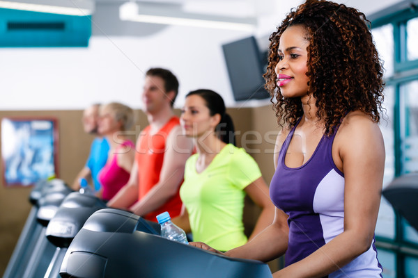Diversiteit groep mensen tredmolen gymnasium groep jonge Stockfoto © Kzenon