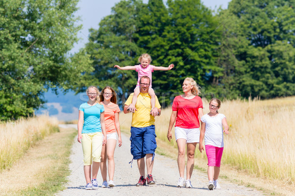 Family having walk on path in summer Stock photo © Kzenon