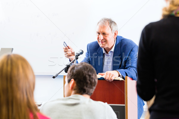 College professor giving lecture for students Stock photo © Kzenon